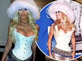 kim kardashian transforms into 90s pamela anderson wearing sexy bustier and fuzzy pink hat