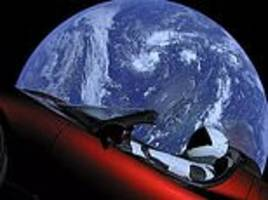 elon musk's tesla roadster which he fired into space has now flown past mars, spacex confirms