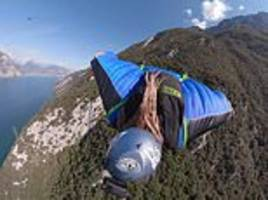 Stunning footage shows wingsuit diver soaring down an Italian mountainside