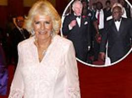charles and camilla attend a state banquet on the last night of their ghanaian tour