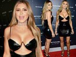 larsa pippen turns heads in a plunging pvc dress as she makes the most of her new single status