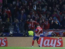 champions league: atletico wins to join dortmund at the top
