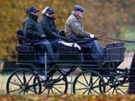 Prince Philip enjoys a carriage ride at Windsor Castle