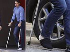 rafael nadal hobbles from medical centre on crutches following ankle surgery