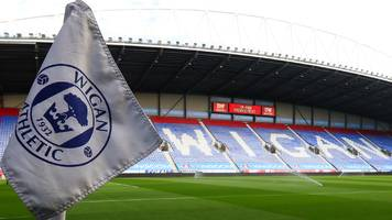 wigan athletic: whelan family sell championship club to international entertainment corporation