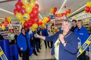 shoppers queue outside new bargain buys store in freshney place to grab lots of opening-day offers