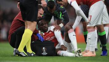 Arsenal's Danny Welbeck Stretchered Off vs. Sporting CP After Horrific Injury