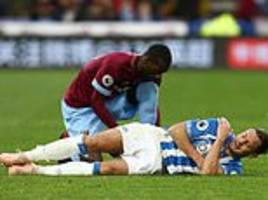 Huddersfield suffer injury blow as defender Christopher Lowe sustains suspected shoulder damage