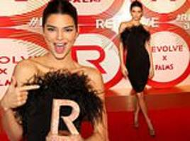 Kendall Jenner cuts a sophisticated figure accepting the Icon of the Year prize at Revolve Awards