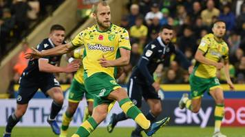 two injury-time goals send norwich top of table