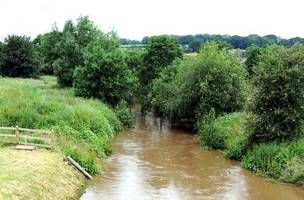 a flood alert has been issued for the river medway as kent is battered by heavy rain