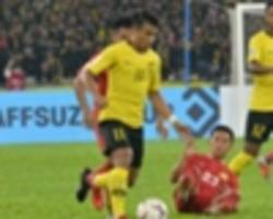 Akhyar the bright spark for Malaysia in narrow win