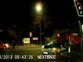dramatic moment driver fails to see oncoming car and causes a pile-up when they turn right