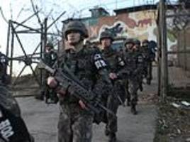 north and south korea start to tear down guard posts and withdraw troops along the border