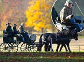 prince philip, 97, takes the reins on a carriage ride in windsor great park