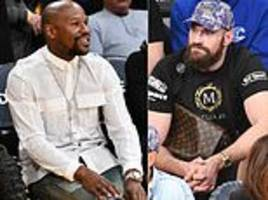 tyson fury and floyd mayweather watch on as lebron james earns la lakers dramatic win