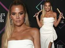 khloe kardashian looks radiant in white while taking home two trophies from people's choice awards