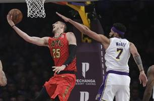 James' dunk lifts Lakers to 107-106 win over Hawks