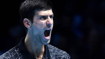 ATP Finals: Novak Djokovic beats John Isner in group opener