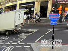 horrifying moment commuter is shoved in front of a taxi