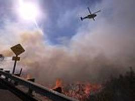 incredible footage shows californians fleeing latest fires as flames lick sides of the interstate
