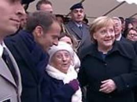 Woman, 101, mistakes Angela Merkel for Emmanuel Macron's wife at Armistice Day event