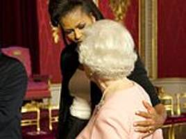 michelle obama: how i feared a royal faux pas when i put my arm round queen