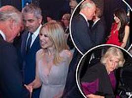 Prince Charles meets Kylie Minogue and Cheryl - along with Sooty - at London Palladium show