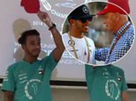 lewis hamilton and mercedes pay tribute to niki lauda with red caps as they celebrate fifth title