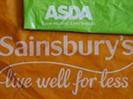 german rivals cost us billions: sainsbury's and asda plead with watchdog to clear £14bn merger