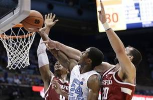 No. 7 North Carolina beats Stanford 90-72 in 1st home game
