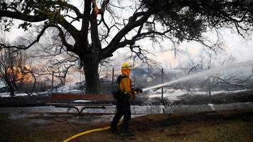 California fires: Firefighters hold containment lines in north