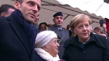 Old lady mistakes Chancellor Merkel for Macron's wife