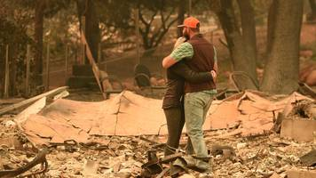california fires: winds propel fires as death toll rises