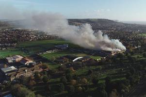 incredible drone footage shows folkestone morrisons fire as smoke billows out across the sky