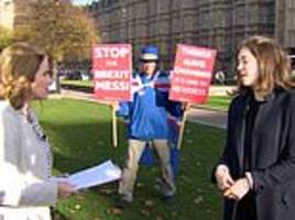 Brexit protester crashes BBC news interview outside Houses of Parliament in London