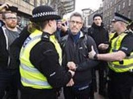 protestor is arrested as demonstrators turn out in force to greet steve bannon to edinburgh