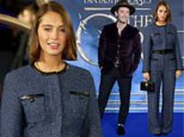 iris law flaunts her sartorial flair in bouchlé as she joins dad jude at fantastic beasts premiere