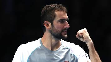 cilic fights back to stay in contention for semi-final place