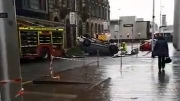 Overturned car leads to delays in Glasgow city centre