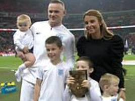 Coleen Rooney is joined by children as they support Wayne Rooney during emotional England send-off