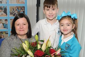 Grateful Greenhill pupils say it with flowers for depute head
