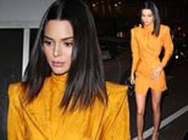 kendall jenner makes a statement in a bright orange minidress as she attends glitzy bash in london
