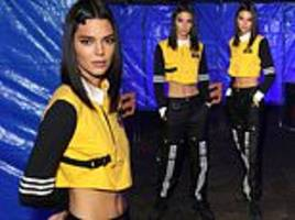 kendall jenner nails sports luxe in a cropped rugby shirt and tracksuit bottoms at adidas launch