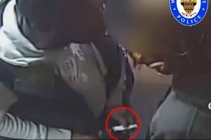 chilling cctv shows thug pull knife before repeatedly stabbing man in takeaway after becoming 'angry at food order'