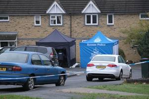 Photos from the scene of Crawley stabbing as flowers left for young man
