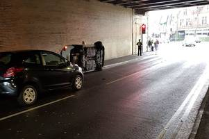 car flips on its side under bridge in pontypridd