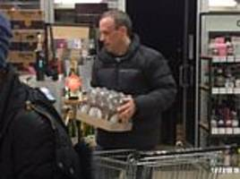 dominic raab looks to be planning a party as he loads up on beer... just three days after resigning