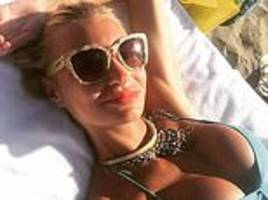 Smirnoff heiress and ex-Miss Russia is CLEARED of hiring 'fake bailiff'