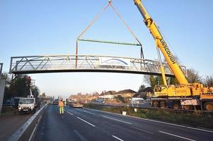 first close up pictures of the m20 teapot lane bridge being put together from the ground